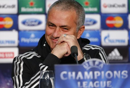 Chelsea manager Jose Mourinho smiles as he addresses a news conference in Basel November 25, 2013. Chelsea will play against Basel in the Ch