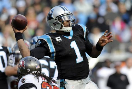 Dec 1, 2013; Charlotte, NC, USA; Carolina Panthers quarterback Cam Newton (1) drops back to pass during the second half of the game against