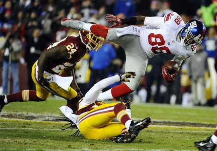 Dec 1, 2013; Landover, MD, USA; New York Giants wide receiver Hakeem Nicks (88) is tackled by Washington Redskins safety Brandon Meriweather