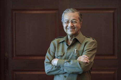 Former Malaysian prime minister Mahathir Mohamad poses for a picture after an interview at his office in Kuala Lumpur October 18, 2013. REUT