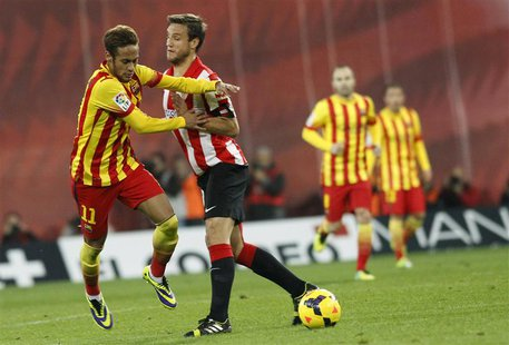 Barcelona's Neymar (L) is challenged by Athletic Bilbao's Carlos Gurpegui (2nd L) during their Spanish first division soccer match at San Ma