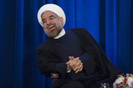 Iran's President Hassan Rouhani laughs as he speaks during an event hosted by the Council on Foreign Relations and the Asia Society in New Y