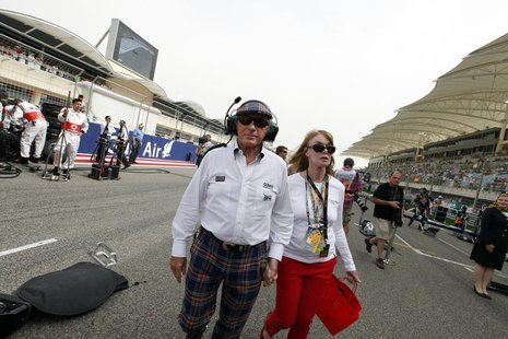 Former Formula One champion Sir Jackie Stewart walks in the grid with his wife Helen before the Bahrain F1 Grand Prix at the Sakhir circuit