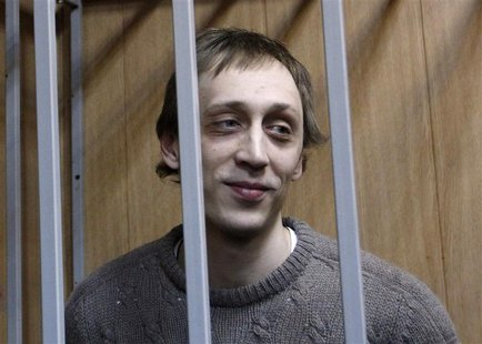 Dancer Pavel Dmitrichenko looks out from the defendant's holding cell during a hearing in Moscow in this October 22, 2013 file photo. REUTER