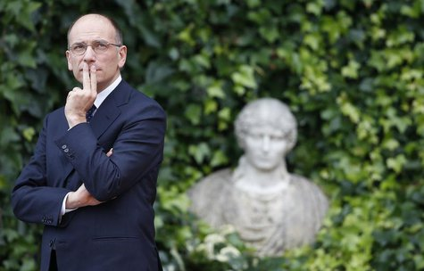 Italian Prime Minister Enrico Letta looks up as he waits for the arrival of his Israeli counterpart Benjamin Netanyahu at Villa Madama in Ro