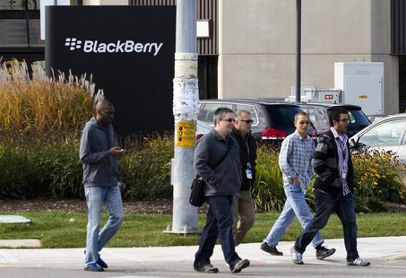 People walk in front of the Blackberry campus in Waterloo, September 23, 2013. REUTERS/Mark Blinch