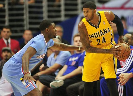 December 1, 2013; Los Angeles, CA, USA; Indiana Pacers small forward Paul George (24) controls the ball against the defense of Los Angeles C