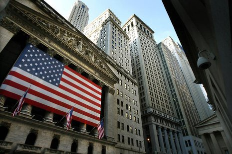 An American flag hangs over the exterior of the New York Stock Exchange in New York, October 9, 2008. REUTERS/Mike Segar