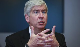Rick Snyder, the Republican governor of Michigan, speaks during an interview in New York, November 8, 2013. REUTERS/Shannon Stapleton