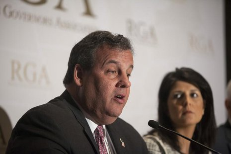 Governor Chris Christie (R-NJ) answers a question during a news briefing at the 2013 Republican Governors Association conference in Scottsda
