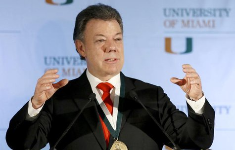 Colombia's President Juan Manuel Santos gestures as he addressed a gathering at the University of Miami in Coral Gables, Florida, December 2