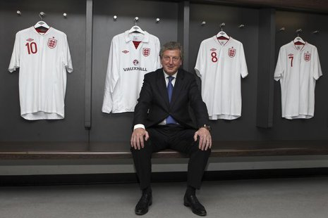 Newly appointed England soccer manager Roy Hodgson poses for a photograph in the home dressing room at Wembley Stadium in London May 1, 2012