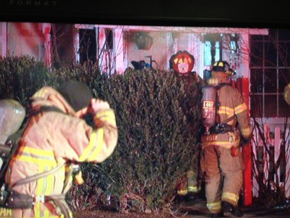 Crews respond to a house fire in Green Bay on December 1, 2013. (Photo from: FOX 11).