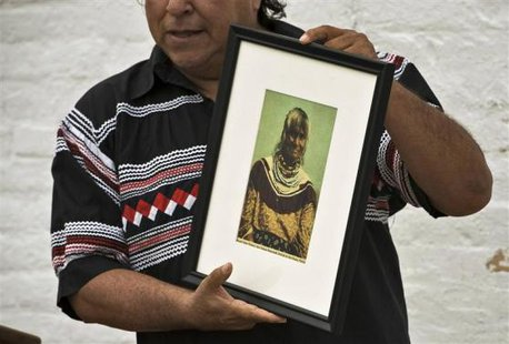 "Seminole Tribe member and historian Willie Johns holds up a photograph of Polly Parker during a visit to Egmont Key State Park as part of a historic journey to retrace the ""Voyage of Tears"" in Egmont More... CREDIT: REUTERS/STEVE NESIUS"