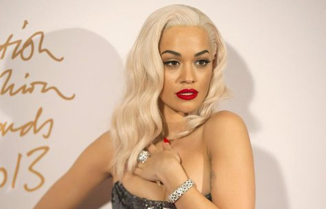 British singer Rita Ora poses for photographs at the British Fashion Awards in London December 2, 2013. REUTERS/Neil Hall