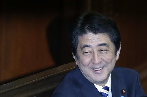 Japan's Prime Minister Shinzo Abe smiles during the Lower House plenary session of the parliament in Tokyo November 26, 2013. REUTERS/Toru H