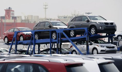 A truck transports cars made by South Korea's Hyundai Motor Group at the company's shipping yard at a port in Pyeongtaek, about 70 km (43 mi