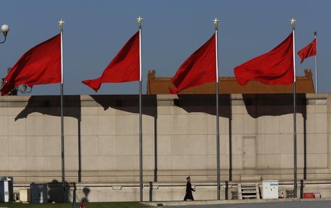 A Paramilitary soldier walks underneath red flags on the Tiananmen square next to the Great Hall of the People where the Chinese Communist P