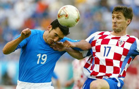 Italy's Gianluca Zambrotta (L) is challenged by Croatia's Robert Jarni (R) during their group G World Cup Finals soccer match in Ibaraki Sta