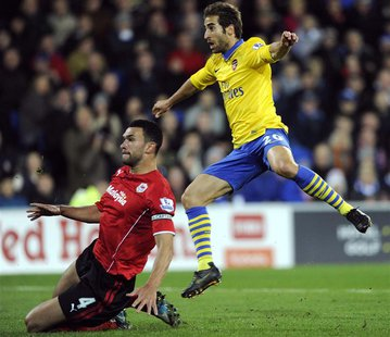 Arsenal's Mathieu Flamini (R) scores a goal against Cardiff City during their English Premier League soccer match at Cardiff City Stadium in