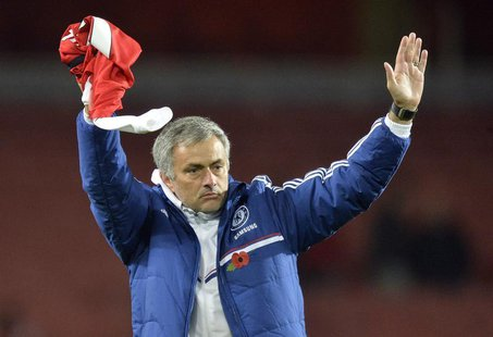 Chelsea's manager Jose Mourinho reacts after their English League Cup fourth round soccer match against Arsenal at Emirates Stadium in Londo