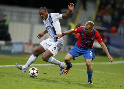 Manchester City's Vincent Kompany (L) challenges Viktoria Plzen's Daniel Kolar during their Champions League group D soccer match at the Doo