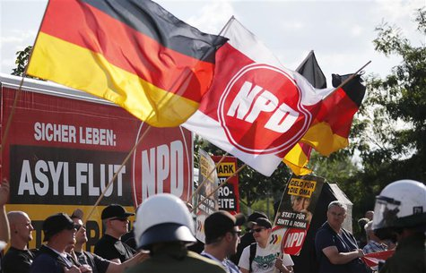 Far-right National Democratic Party (NPD) supporters protest against a refugee asylum in the Hellersdorf district of Berlin, in this August