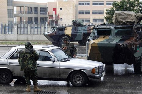 Lebanese army soldiers man a checkpoint during a patrol, following the government's decision to place the northern city under the supervisio
