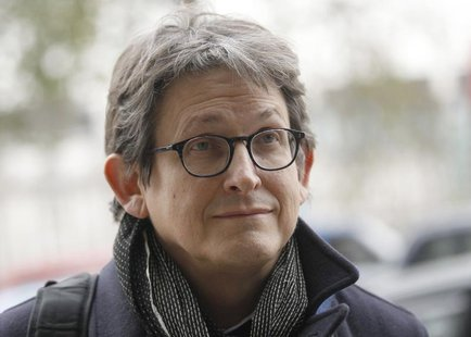 The editor of The Guardian Alan Rusbridger arrives at Portcullis House in London December 3, 2013. REUTERS/Luke MacGregor
