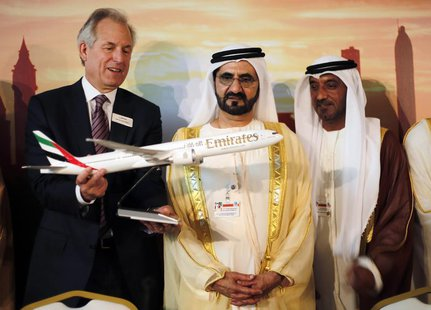 Boeing Chairman James McNerney (L) shows United Arab Emirates' Prime Minister and Ruler of Dubai Sheikh Mohammed bin Rashid al-Maktoum (2nd