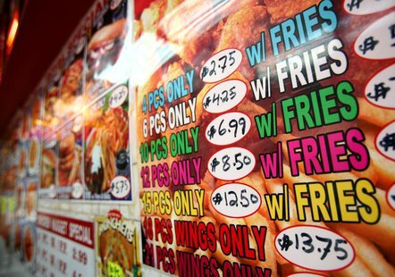 A menu for fried chicken and french fries is displayed on a wall at a fast food restaurant in New York, October 30, 2006. REUTERS/Shannon St