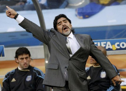 Argentina's coach Diego Maradona gestures during their 2010 World Cup quarter-final soccer match against Germany at Green Point stadium in C