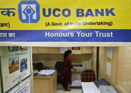 A staff member works inside a commercial branch of the UCO Bank in Mumbai June 1, 2013. REUTERS/Vivek Prakash