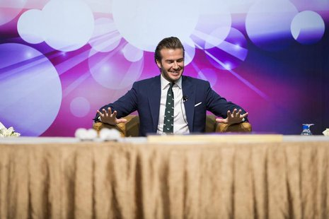 Former England soccer team captain David Beckham reacts during a promotional event at the Venetian Macao hotel in Macau November 22, 2013. R