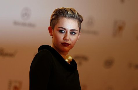 U.S. singer singer Miley Cyrus arrives on the red carpet for the Bambi 2013 media awards ceremony in Berlin November 14, 2013. REUTERS/Tobia