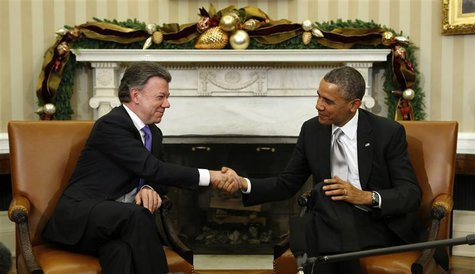 U.S. President Barack Obama shakes hands with Colombian President Juan Manuel Santos during their meeting in the Oval Office of the White Ho