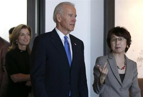 U.S. Vice President Joe Biden (C) and U.S. Ambassador to Japan Caroline Kennedy (L) inspect the headquarters of internet commerce and mobile games provider DeNA Co with the company's founder Tomoko Namba in Tokyo December 3, 2013. CREDIT: REUTERS/TORU HANAI