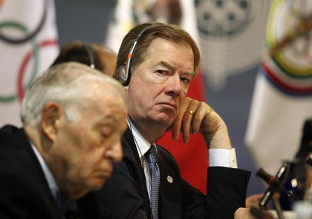 U.S. Olympic Committee chairman Larry Probst (R) looks on during a meeting with the Pan American Games organising committee in Guadalajara M
