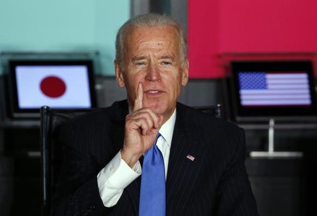 U.S. Vice President Joe Biden (L) gestures as he speaks to Japanese business leaders during their meeting at the headquarters of internet co