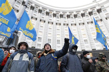 People gather in front of the Ukrainian cabinet of ministers building during a rally to support EU integration in Kiev December 4, 2013. REU