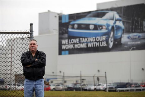 Jeffrey Hand, who was employed with Ford Motor Company for over 14 years, poses for a portrait outside the Ford Flat Rock Assembly Plant in