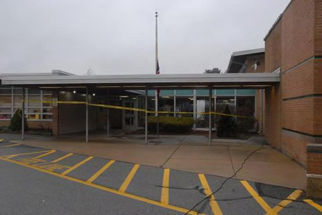 The entrance of Sandy Hook Elementary school is seen after an attack by gunman Adam Lanza in Newtown, Connecticut in this police evidence ph