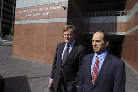 Former KPMG senior auditor Scott London (R) and his lawyer Harland Braun leave the Roybal Federal Court Building after London's hearing in d
