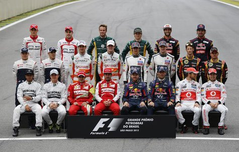 Formula One drivers pose for a group picture ahead of the Brazilian F1 Grand Prix at the Interlagos circuit in Sao Paulo November 24, 2013.
