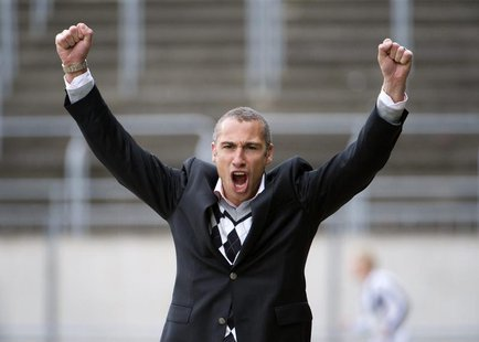 Henrik Larsson celebrates after his team Landskrona Bois scored against Degerfors in their Swedish second football league, Superettan, socce