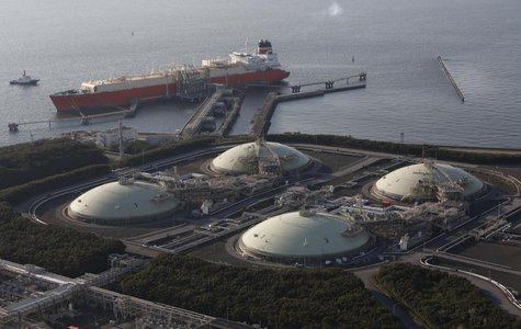 Liquefied natural gas (LNG) storage tanks and a membrane-type tanker are seen at Tokyo Electric Power Co.'s Futtsu Thermal Power Station in