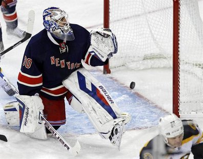 Nov 19, 2013; New York, NY, USA; New York Rangers goalie Henrik Lundqvist (30) reacts to giving up a goal to Boston Bruins right wing Shawn