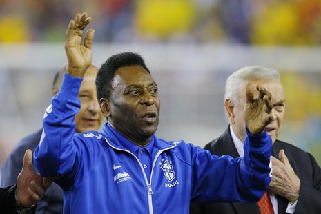 Soccer great Pele waves to the crowd before the international friendly soccer match between Brazil and Portugal in Foxborough, Massachusetts
