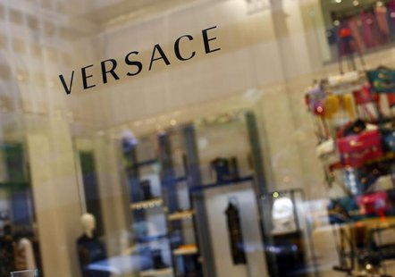 A sign is seen for high-end retail store Versace along 5th Avenue in New York May 19, 2013. REUTERS/Eric Thayer