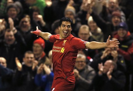 Liverpool's Luis Suarez celebrates scoring a goal against Norwich during their English Premier League soccer match at Anfield in Liverpool,
